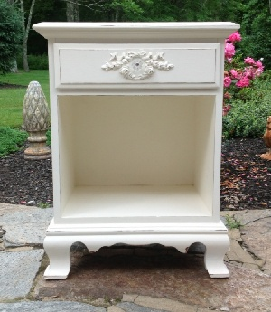 White painted nightstand with rose wreath and crystal knob