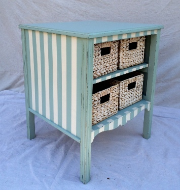 Vintage nursery storage table with baskets