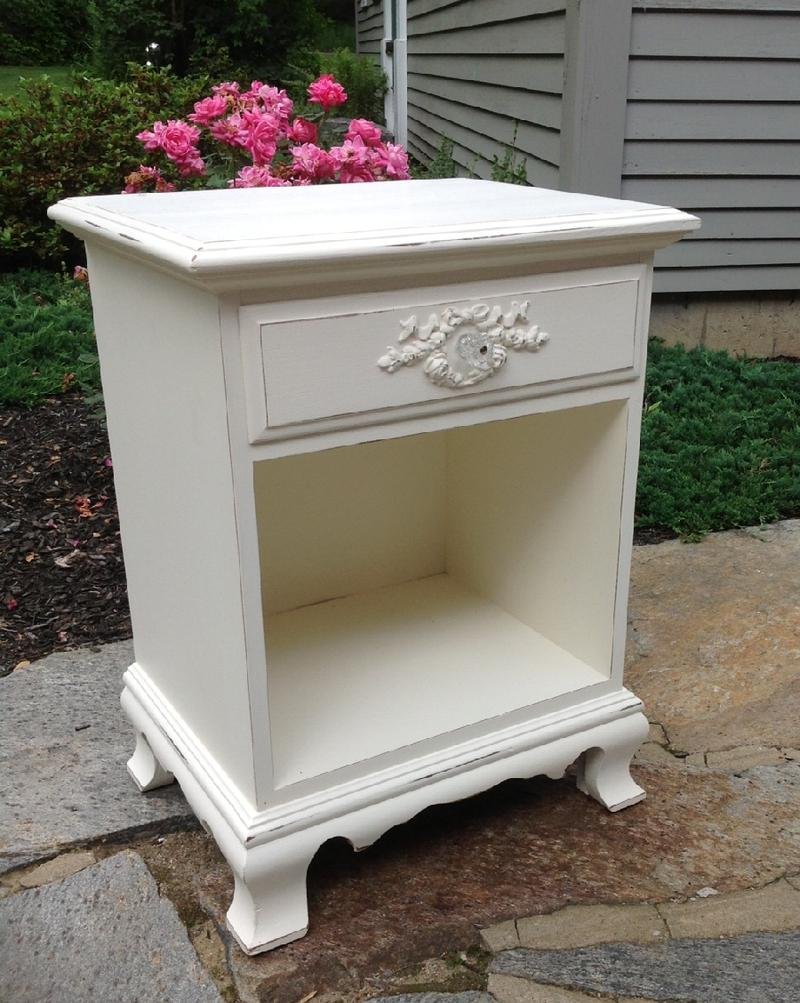 Vintage nightstand painted white with wreath